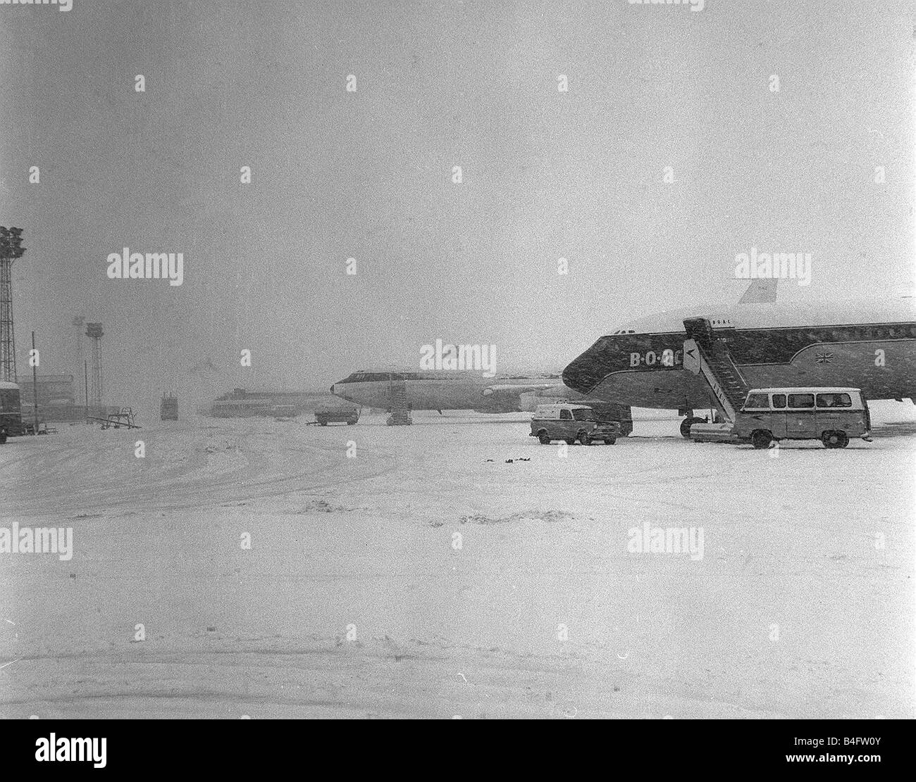 Aircraft parked at Heathrow Airport during a blizard in March 1965 - Stock Image
