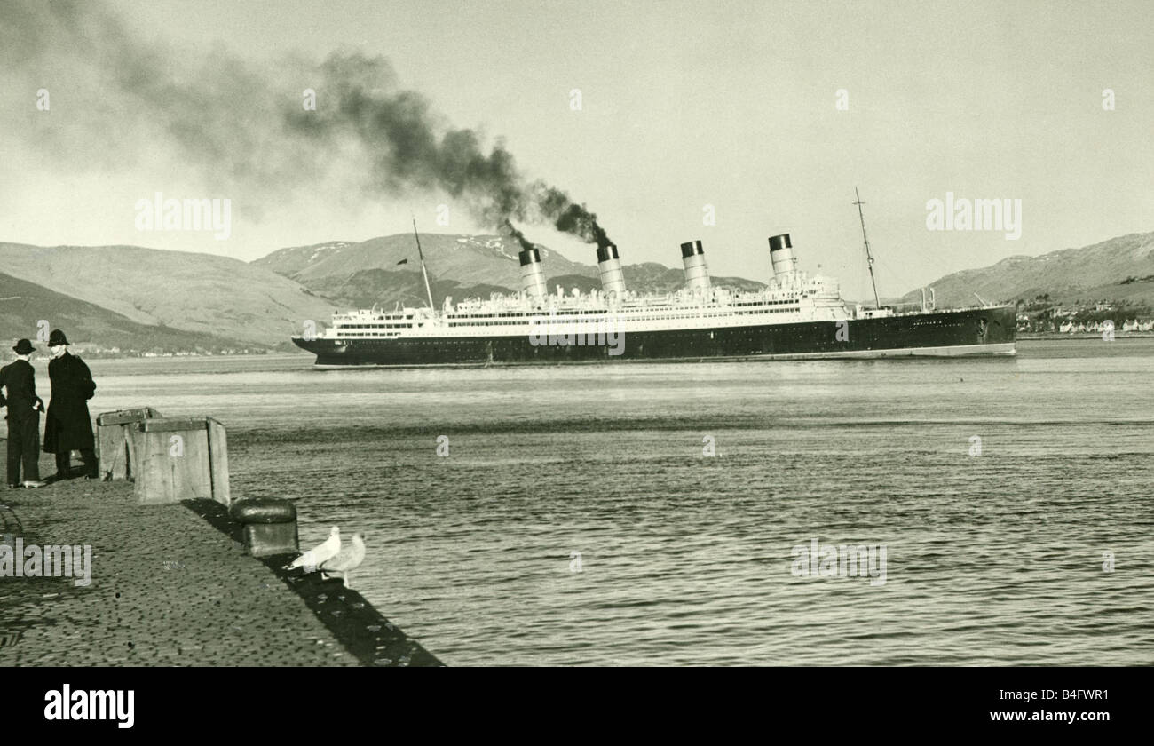 The 44 000 ton RMS Aquitania seen here sailing passed Gourrock Pier on her last journey to the breakers yard at - Stock Image