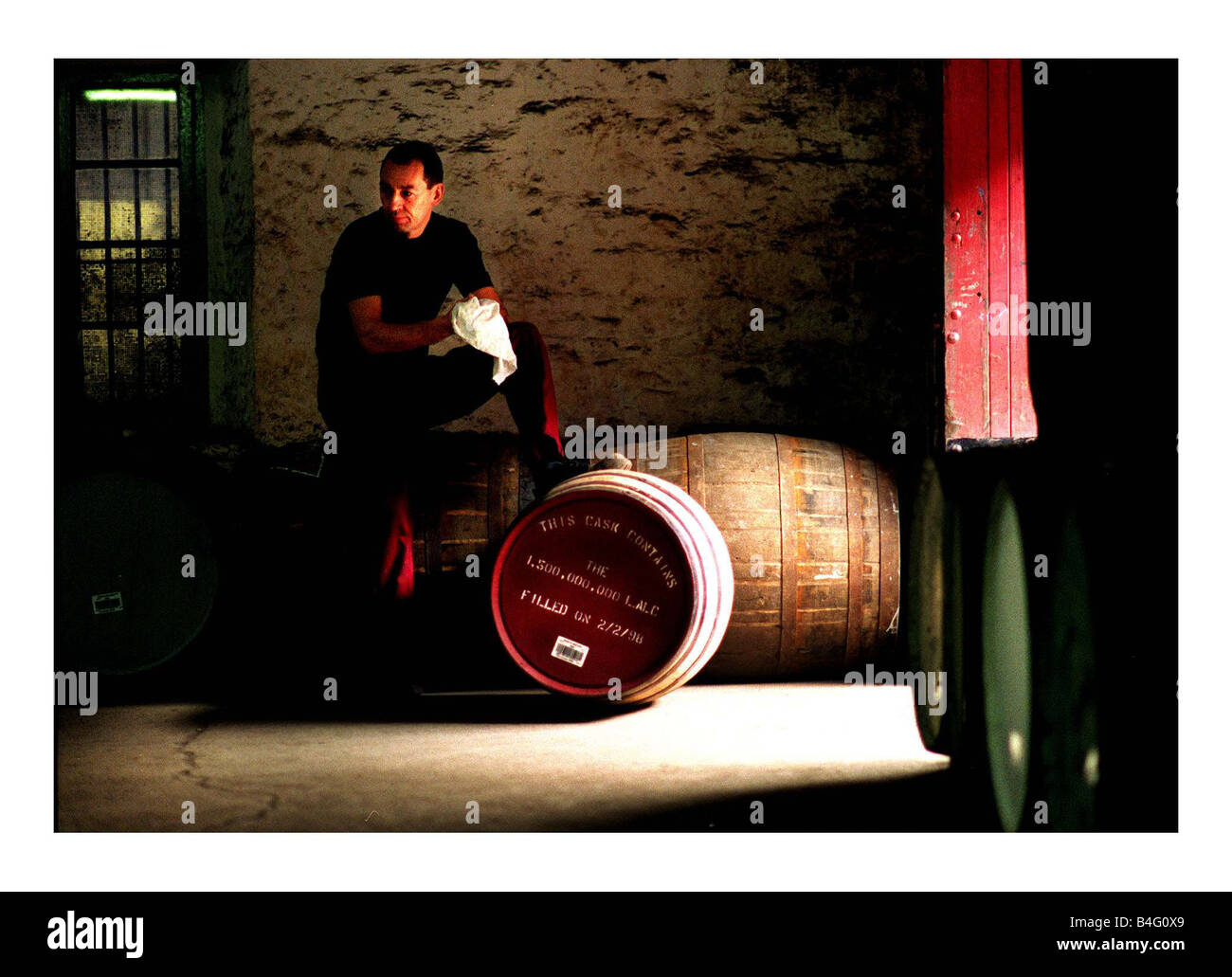 Kenny Matthews with a special whisky cask produced by North British Distillery in Edinburgh Scotland February 1998 - Stock Image