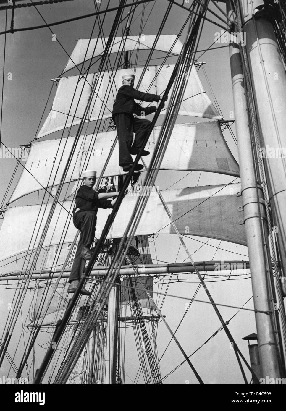 Cadets climbing the main mast of the sailing ship Sorlandet seen here in the English channel Transport Ships Tall - Stock Image