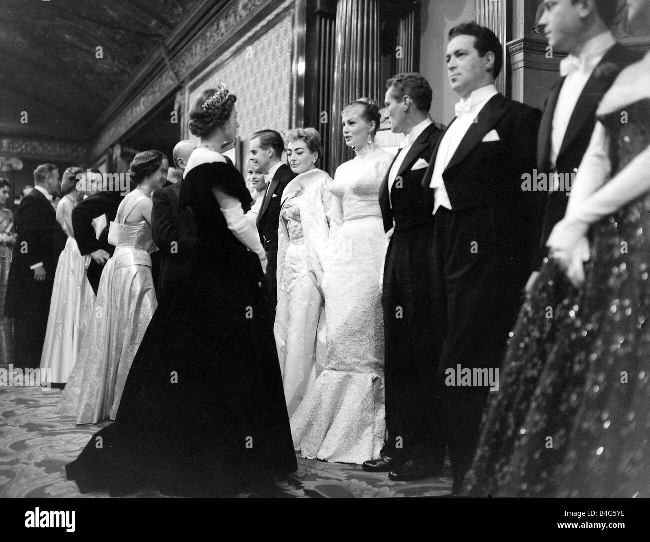 Queen Elizabeth II seen here talking to Actress Anita Ekberg following the 1956 Royal Film Show - Stock Image