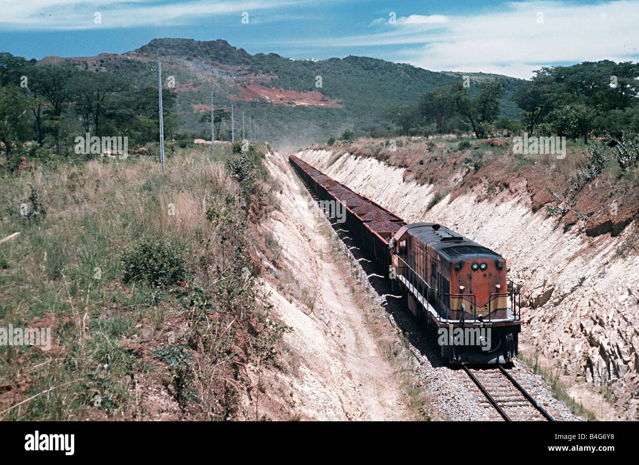 A loaded iron ore train heads for the port of Mocamedes in South West Angola Circa 1975 - Stock Image