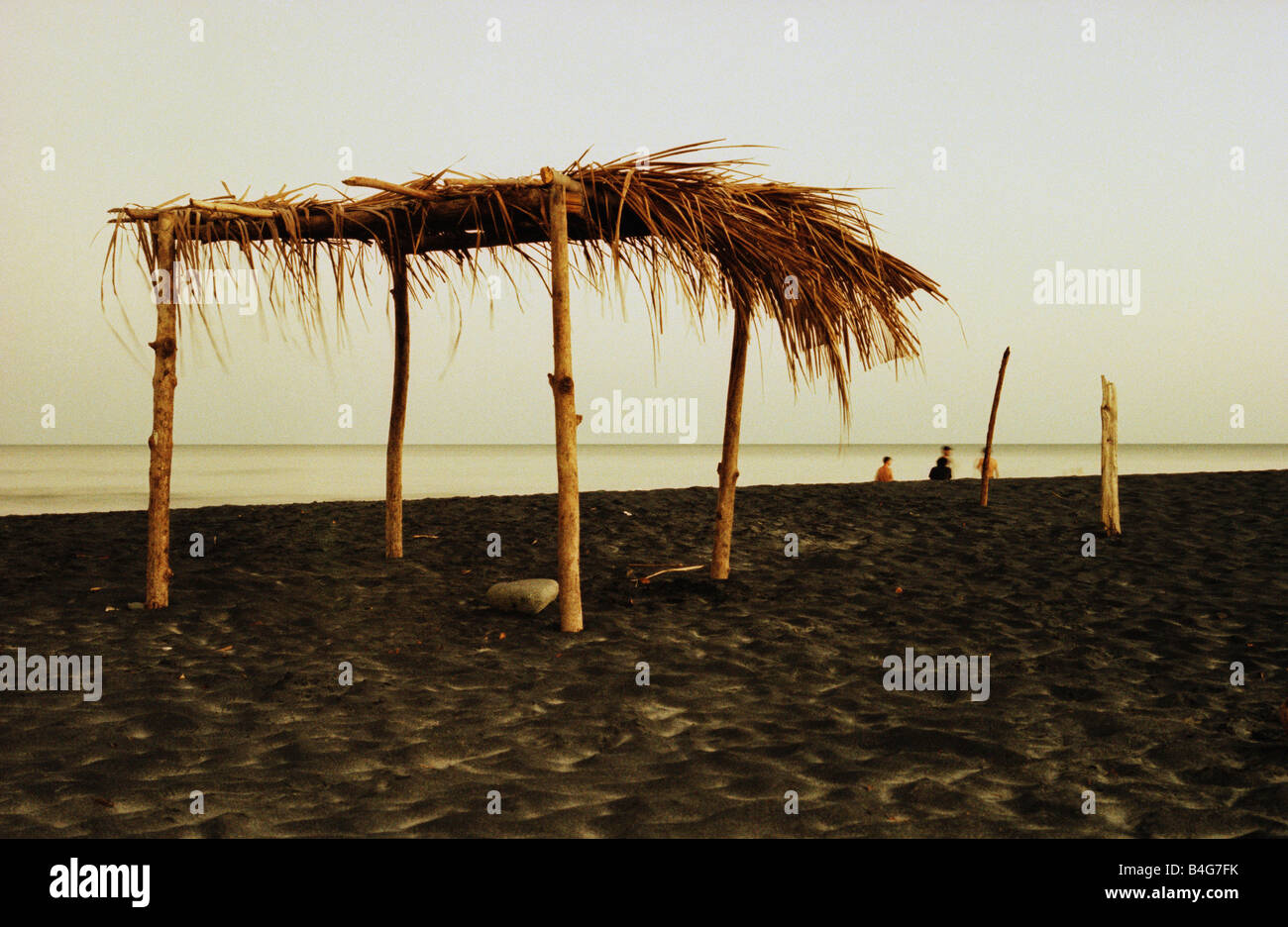 A Palapa shelter on a beach - Stock Image