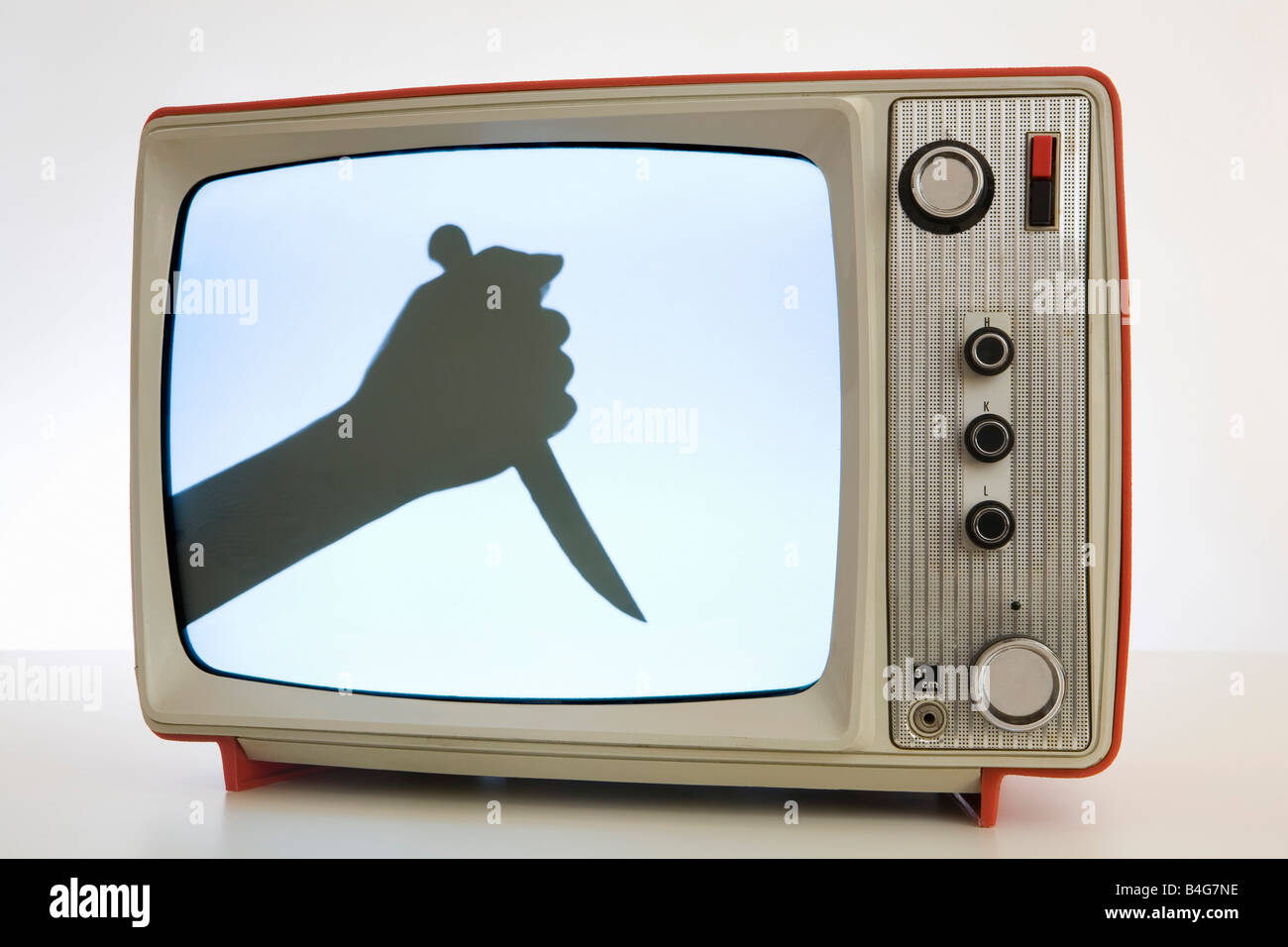 A television with a black and white image of a human hand holding a knife, silhouette - Stock Image