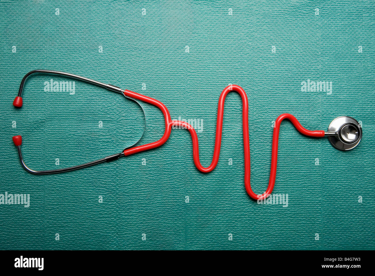 A stethoscope in the shape of a normal EKG graph - Stock Image