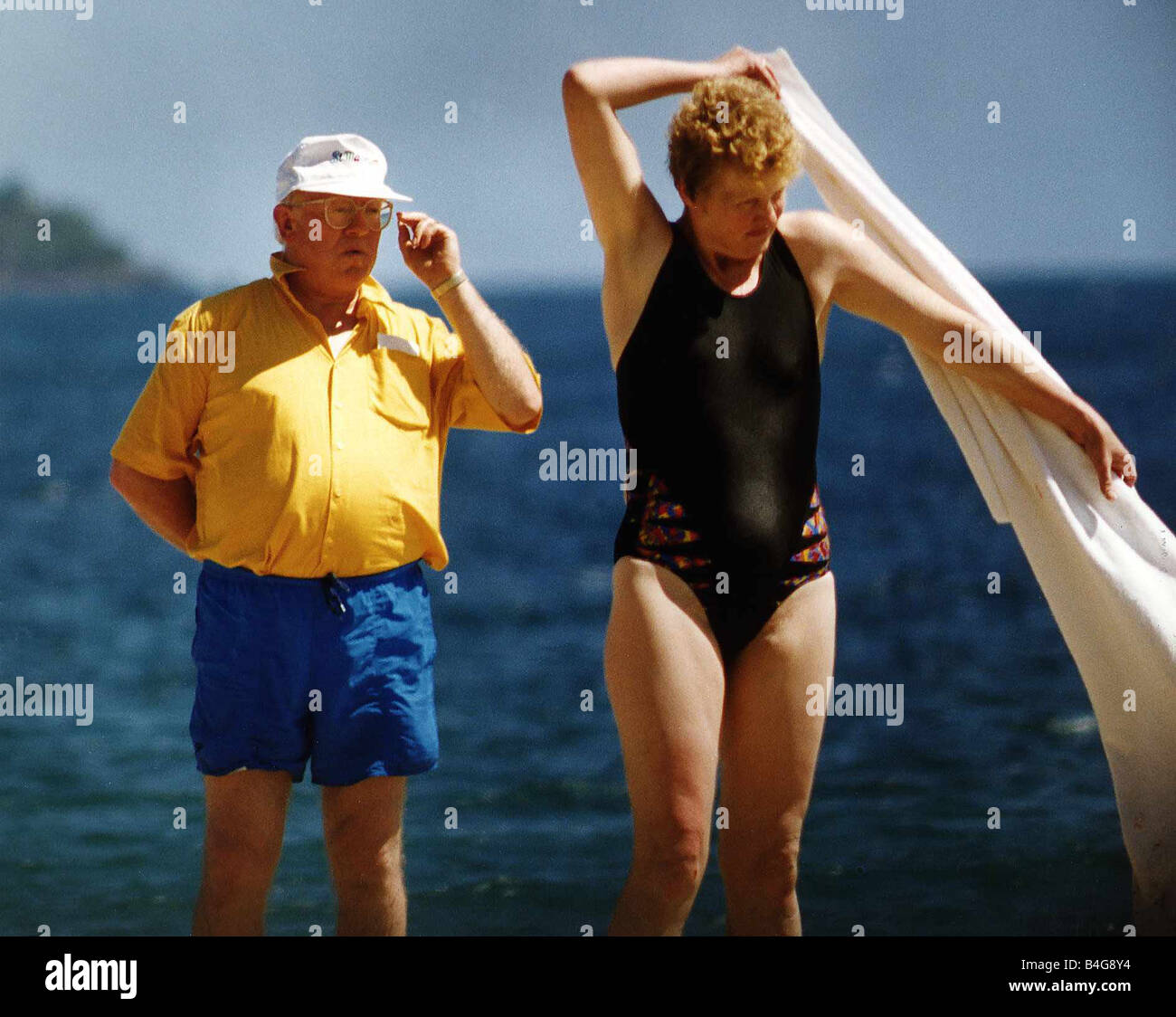 Ken Morley Actor In A Carribean Sunspot Of St Kitts With Mystery Woman - Stock Image
