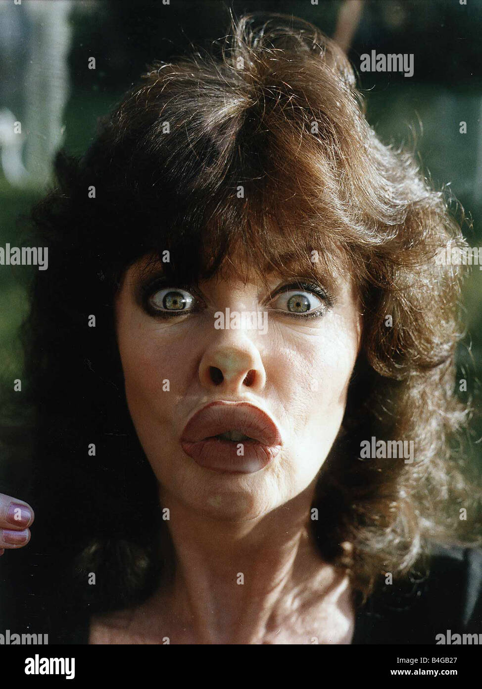Lips Against The Glass.Vicki Michelle Actress With Face Pressed Against Glass Stock