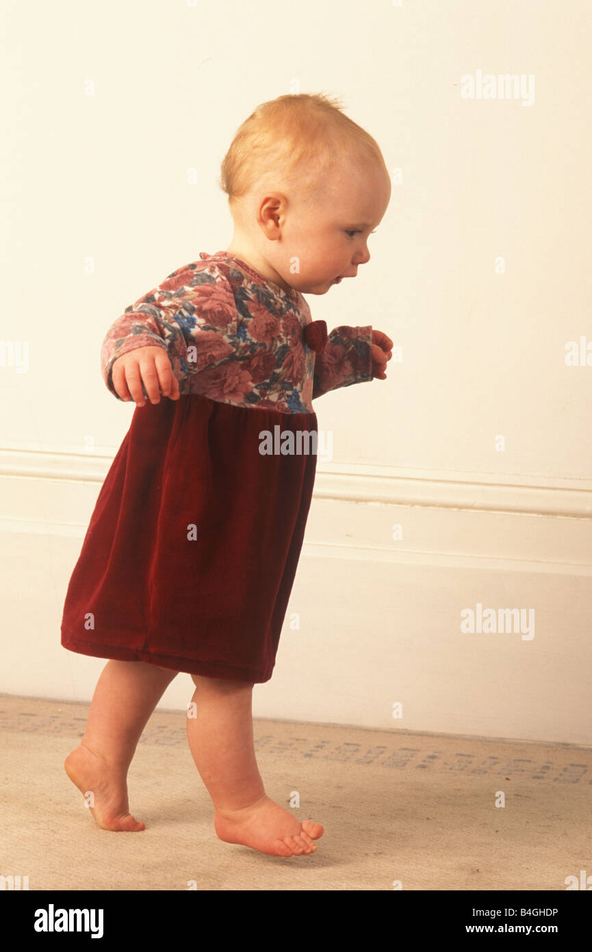 Baby learning to walk - Stock Image