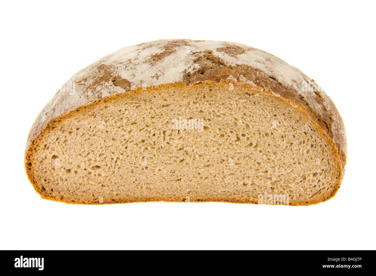 staple food dietary brown bread dark bread german germany rye brot baker bakery leaven sourdough cob loaf cut slice - Stock Image