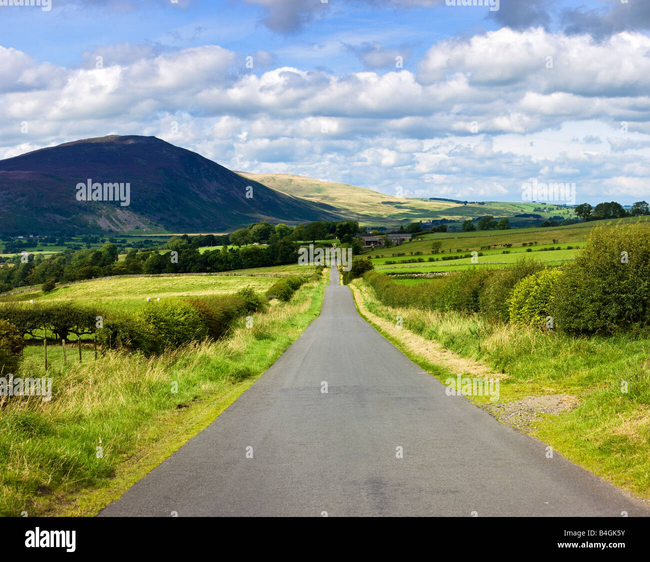 Country road, in the English Lake District, Cumbria, England, UK - Stock Image