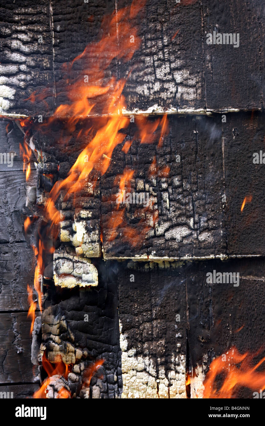 The side of a house on fire - Stock Image