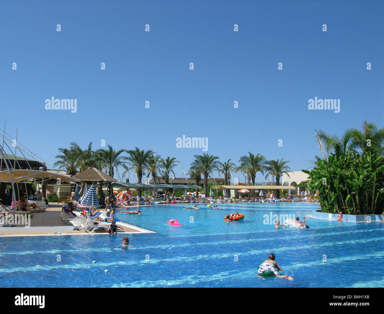 Swimming pool at holiday resort - Stock Image