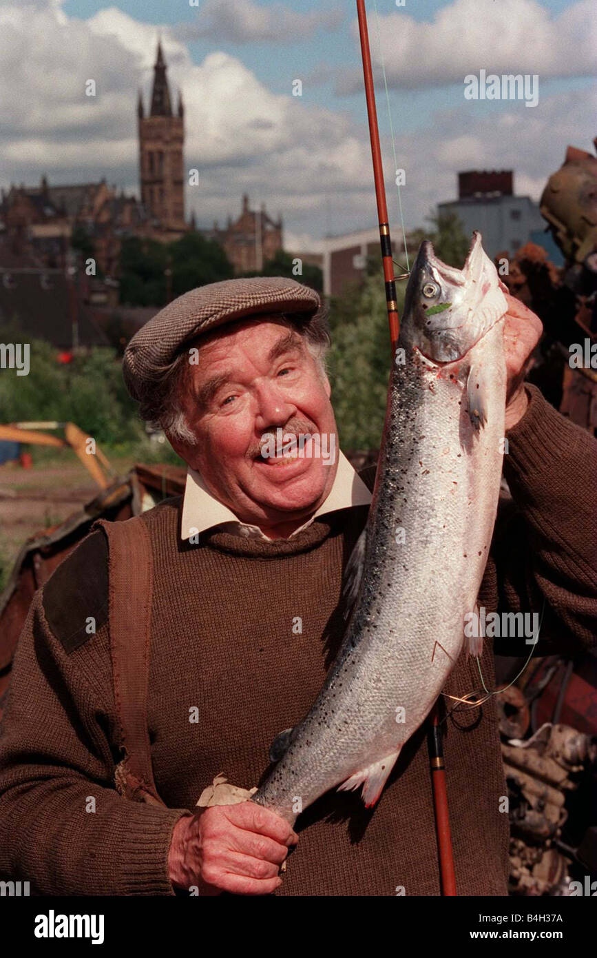 Fisherman Doug Brown with the salmon he caught in the River Clyde August 2001 - Stock Image