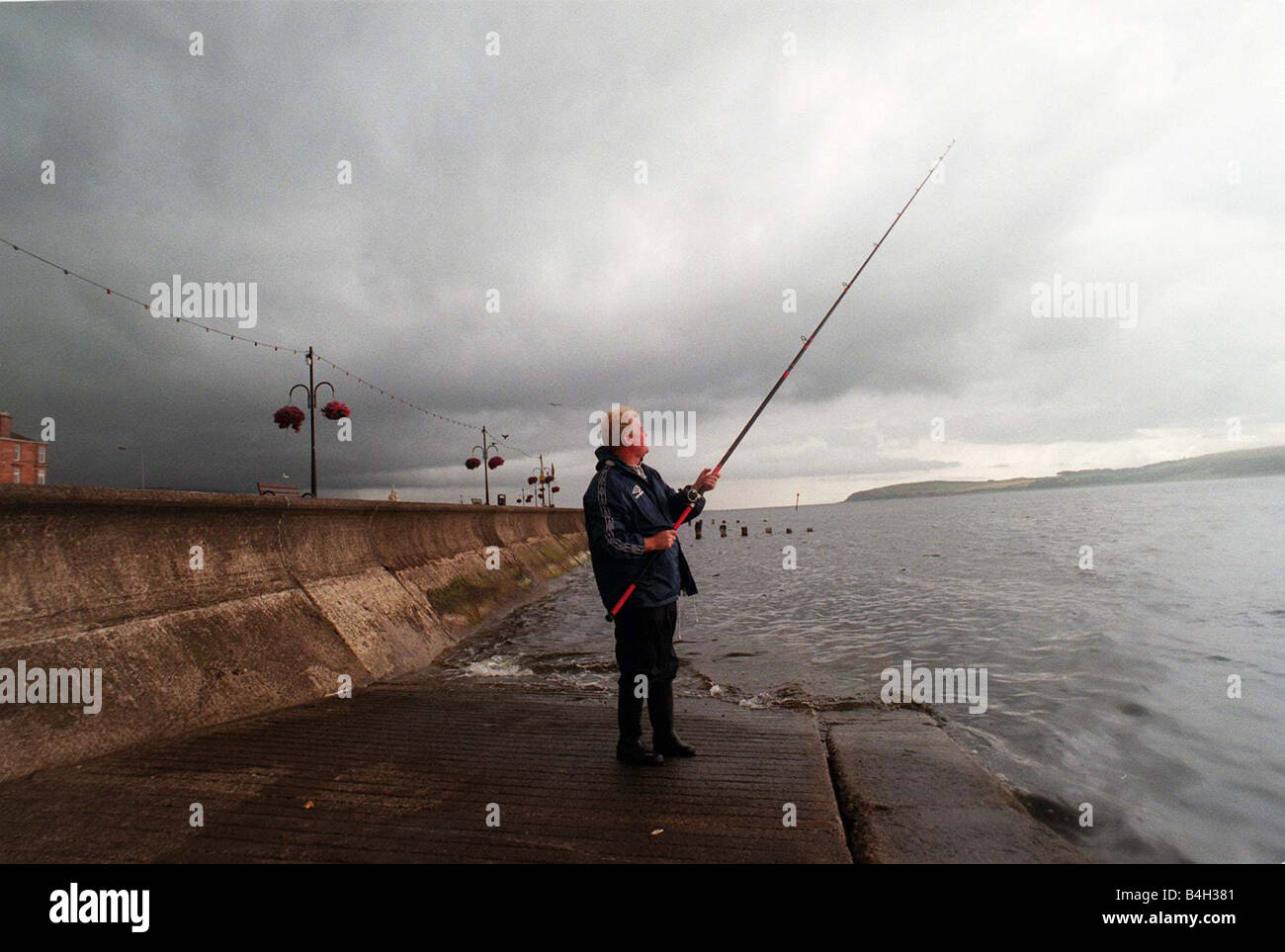 Bob Shields Daily Record features writer August 2000 on fishing trip rod reel bait fish - Stock Image