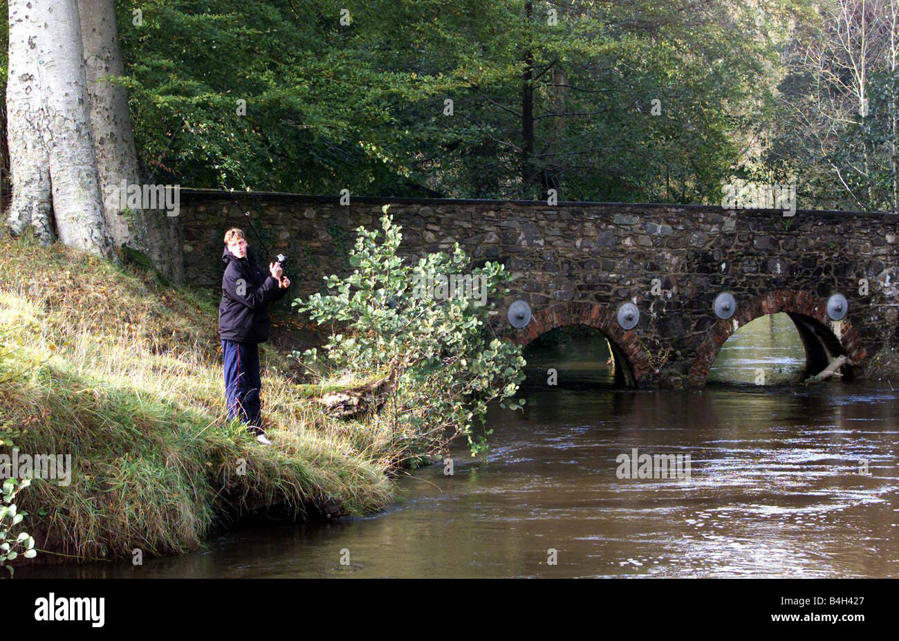 Weather Wreak Havoc Across Ulster October 2002 An angler casting on the fast flowing River Lagan at Shaw s Bridge - Stock Image
