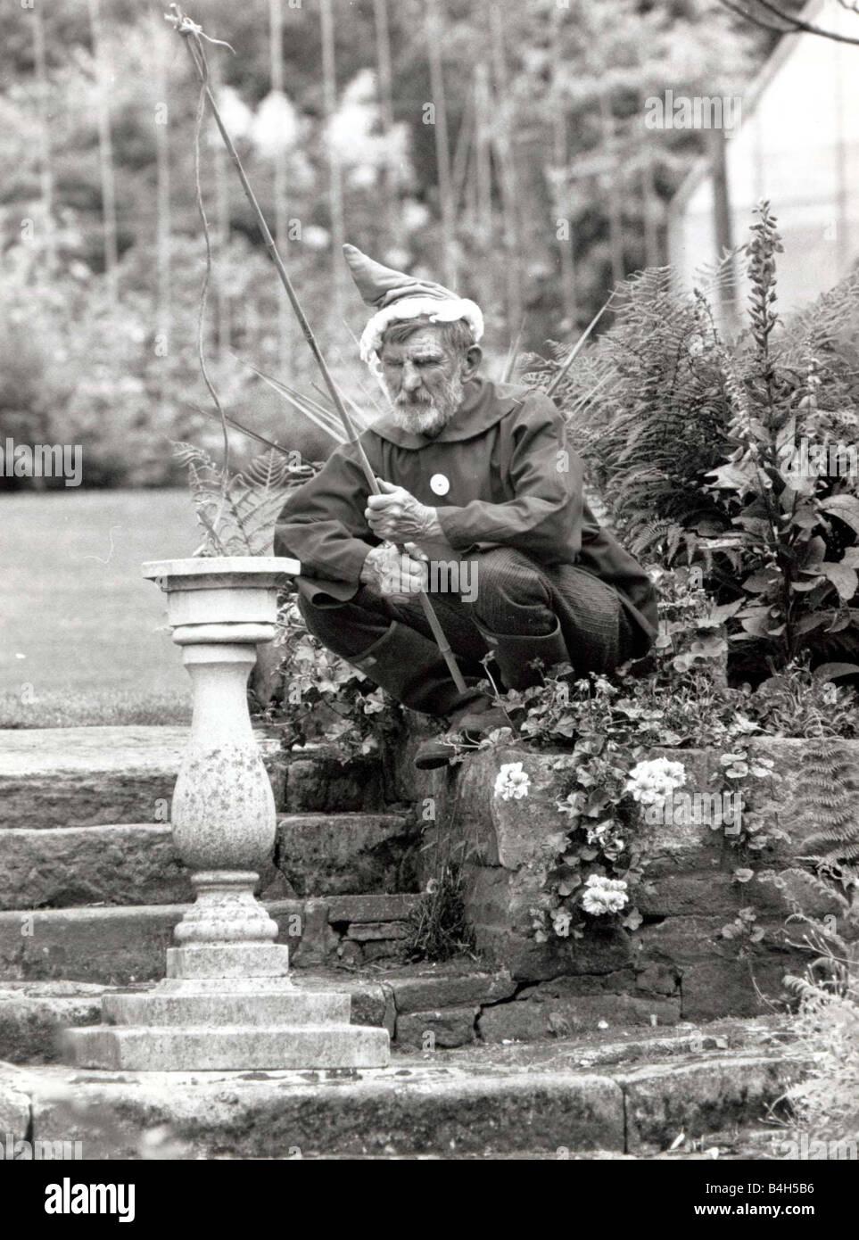 Walter Sherratt aged 67 is posing as a garden gnome in his garden at Biddulph near Stoke on Trent He loves to make - Stock Image