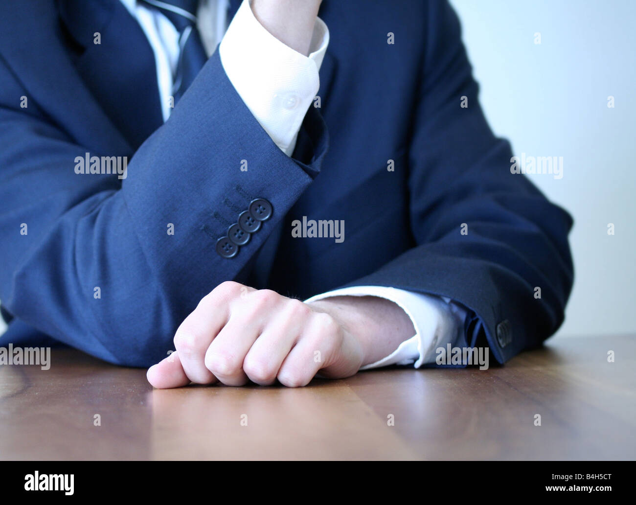 Midsection view of businessman sitting at table in office - Stock Image