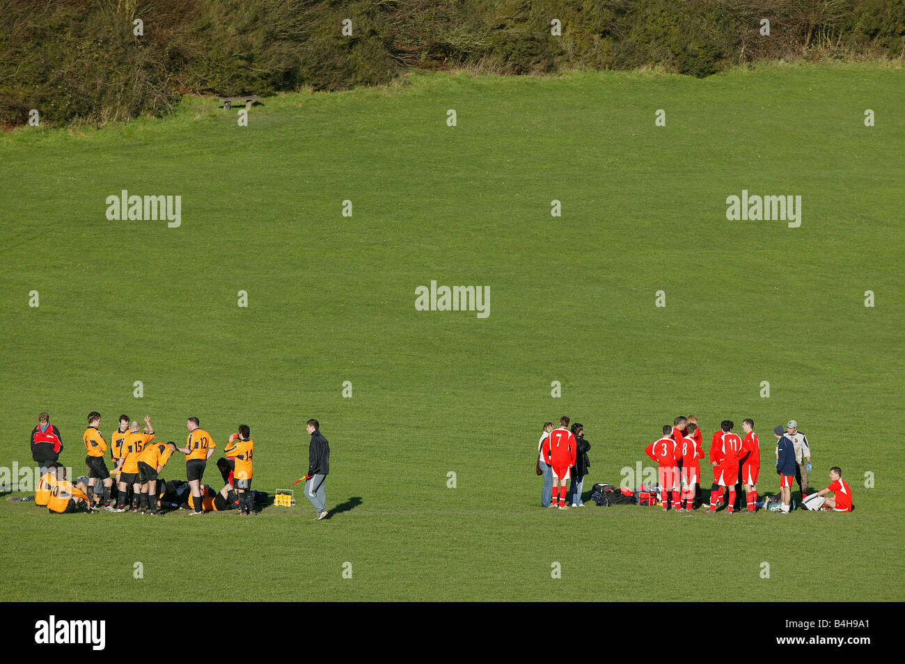 Two Sunday league football teams prepare for a penalty shoot out. - Stock Image