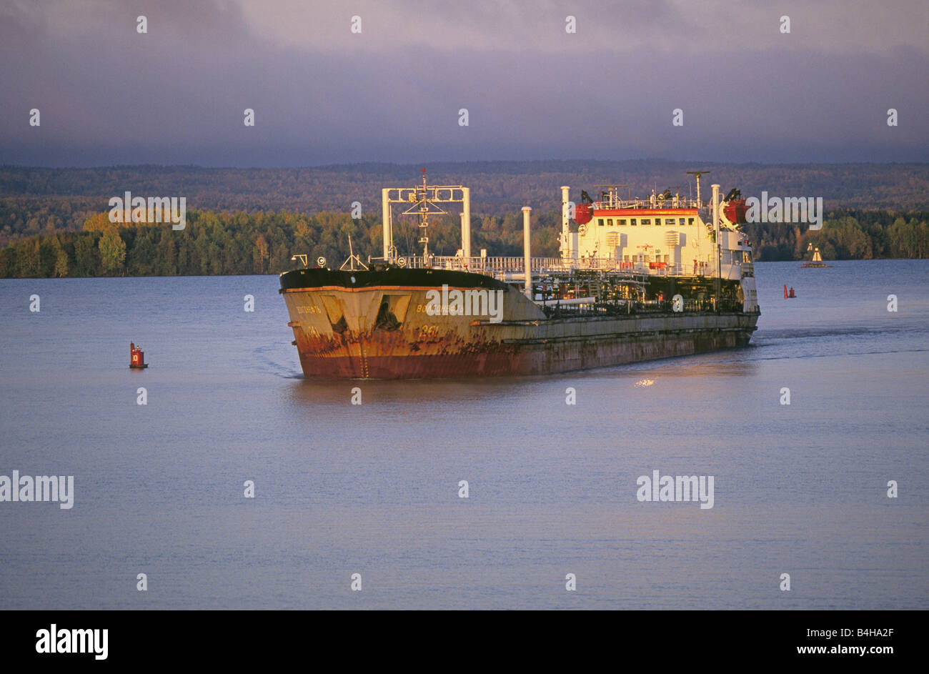 Modern day Volga Boatmen operate a small fuel tanker ship sails upriver on the Volga River between Moscow and St - Stock Image