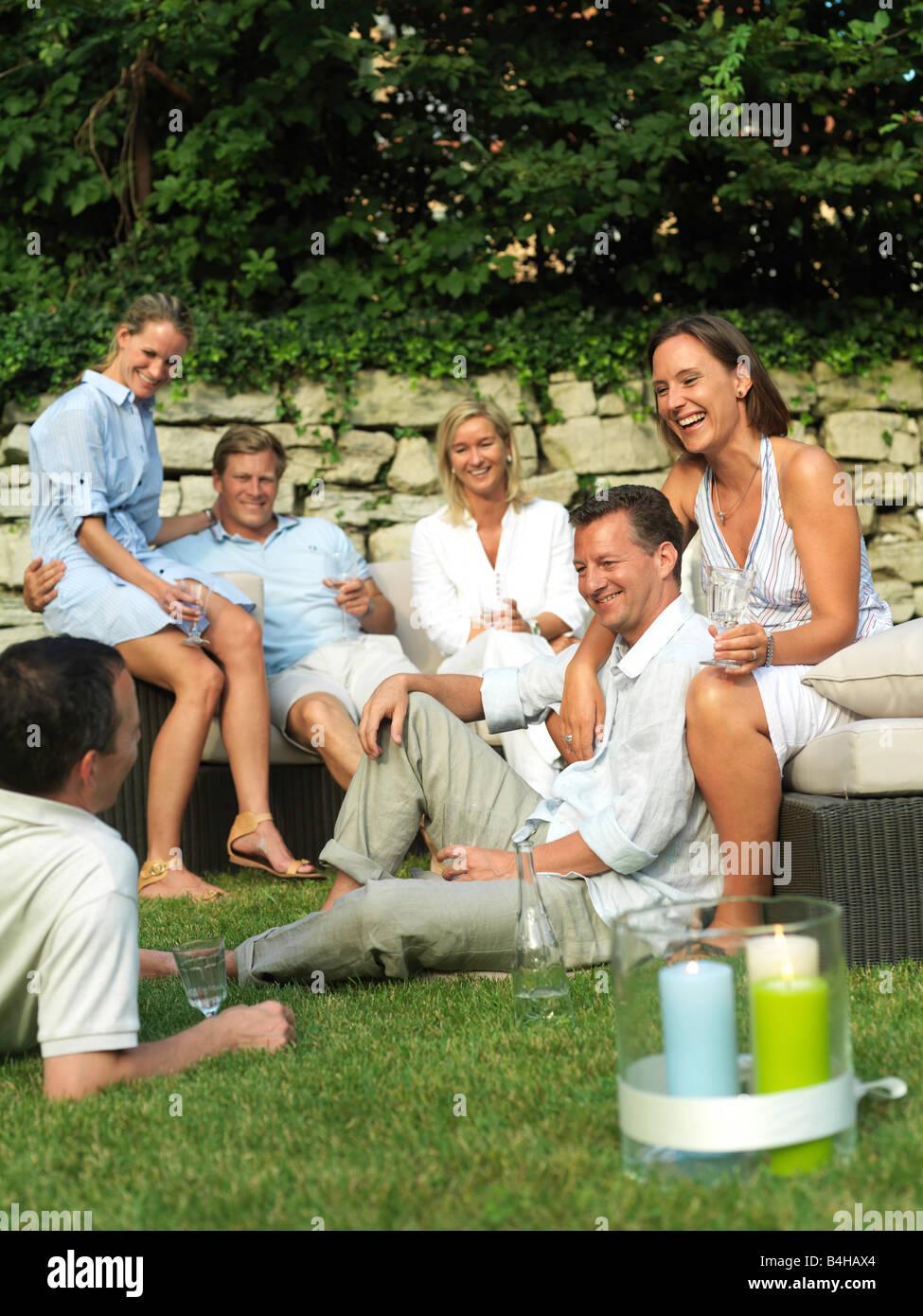 Three couples celebrating garden party - Stock Image