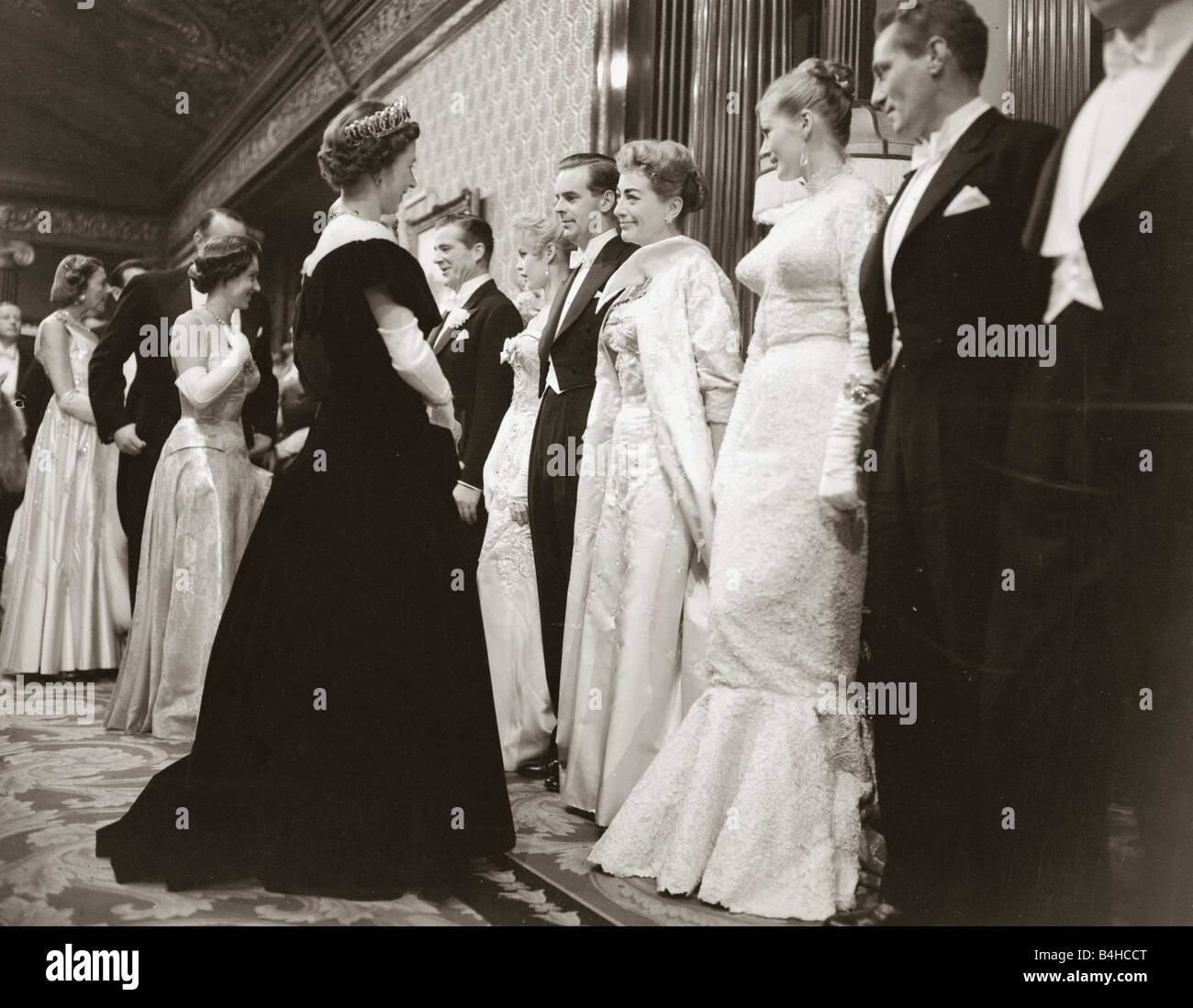 Actress Joan Crawford at the Royal Film Show talking to Her majesty Queen Elibazeth II of England October 1956 - Stock Image