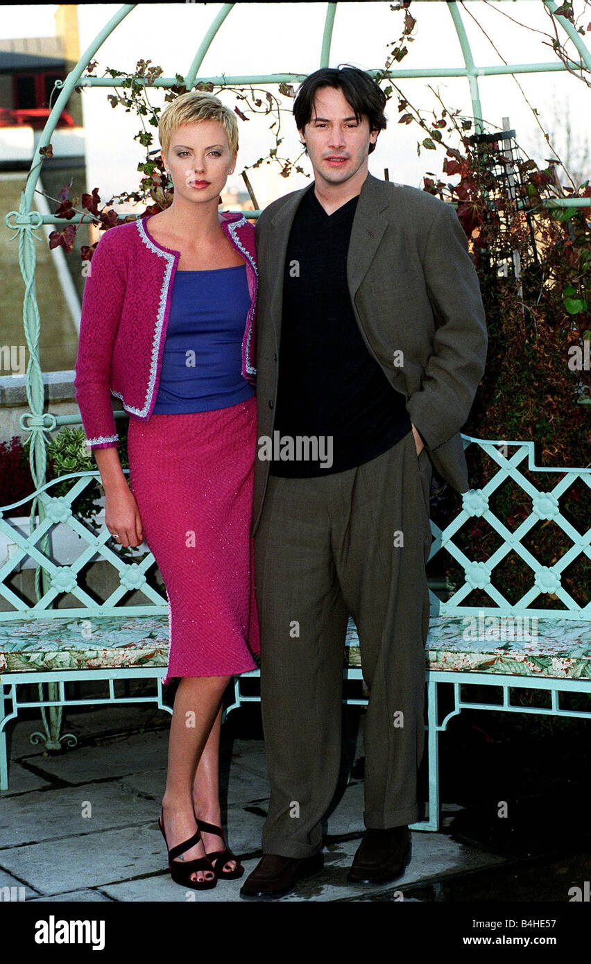 Keanu Reeves Actor December 97 With his co star Charlize Theron at photo call for new film Devil s Advocate Stock Photo