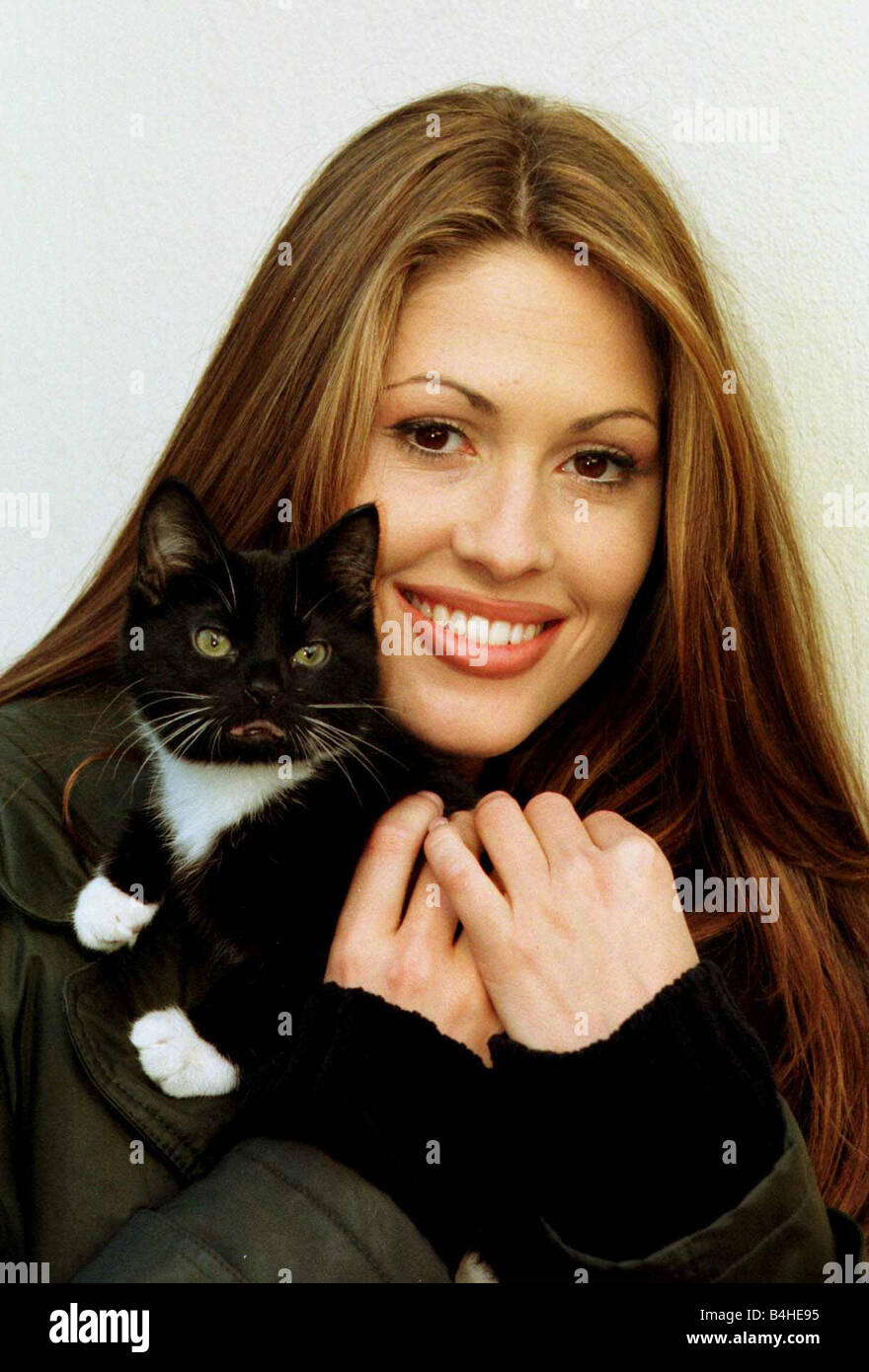 Nicola Charles Neighbours actress and kitten January 1998 Nicola cuddles Poppy the injured stray kitten who is looking - Stock Image
