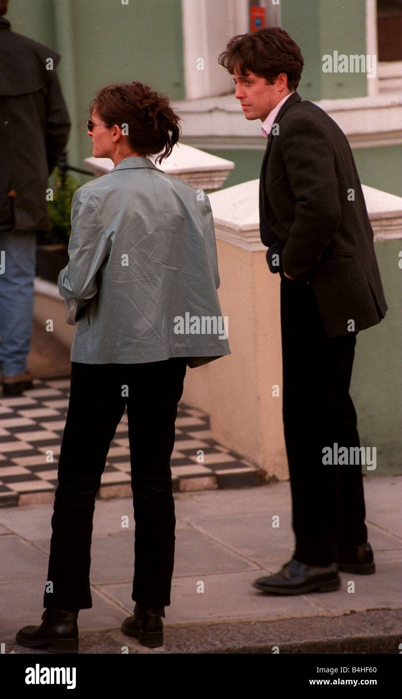 Julia Roberts Actress April 1998 with Hugh Grant Actor on the set of their new film called Notting Hill - Stock Image