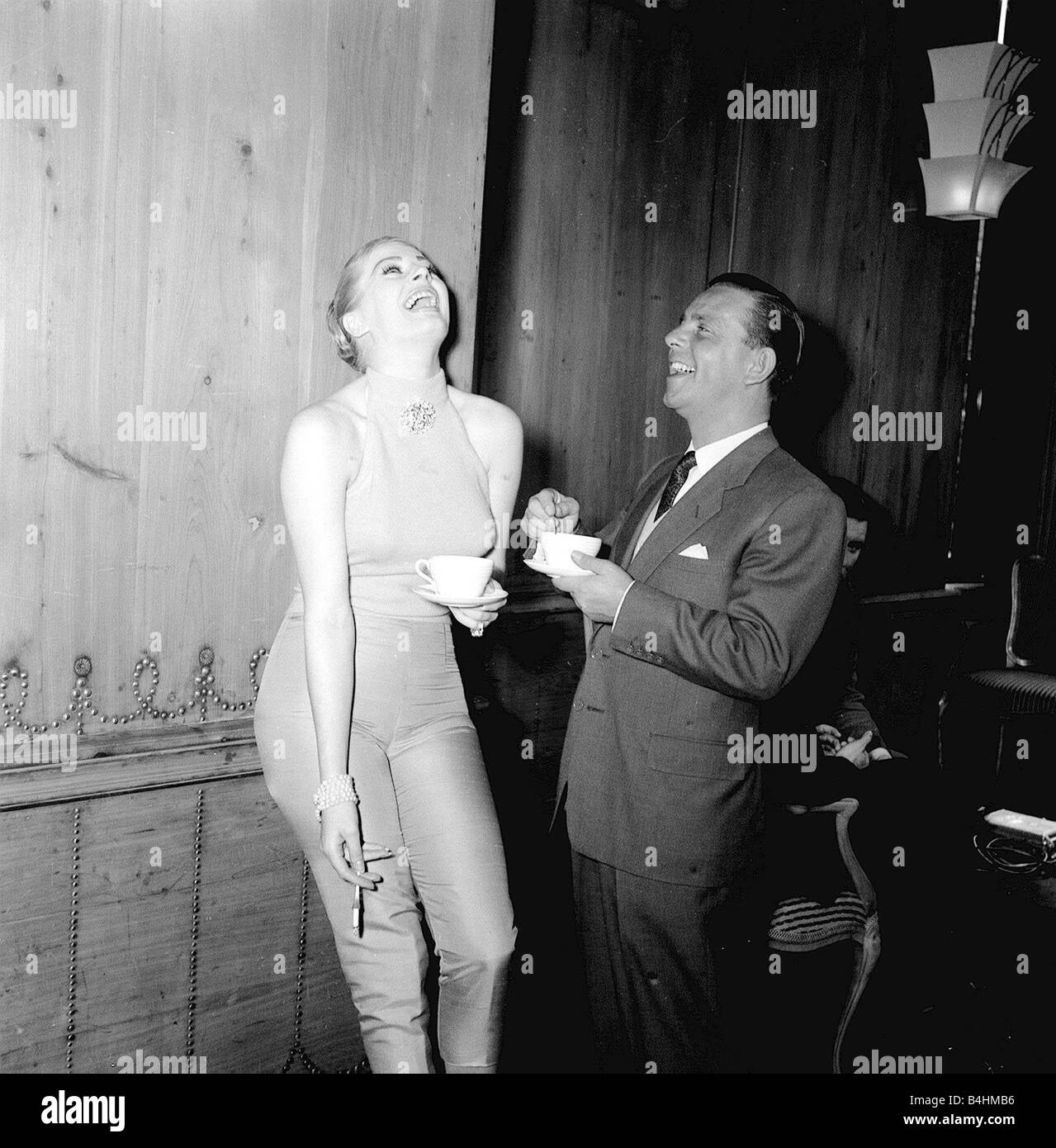 Actor and comedian Norman Wisdom with actress Anita Ekberg at the savoy Hotel in London May 1956 - Stock Image