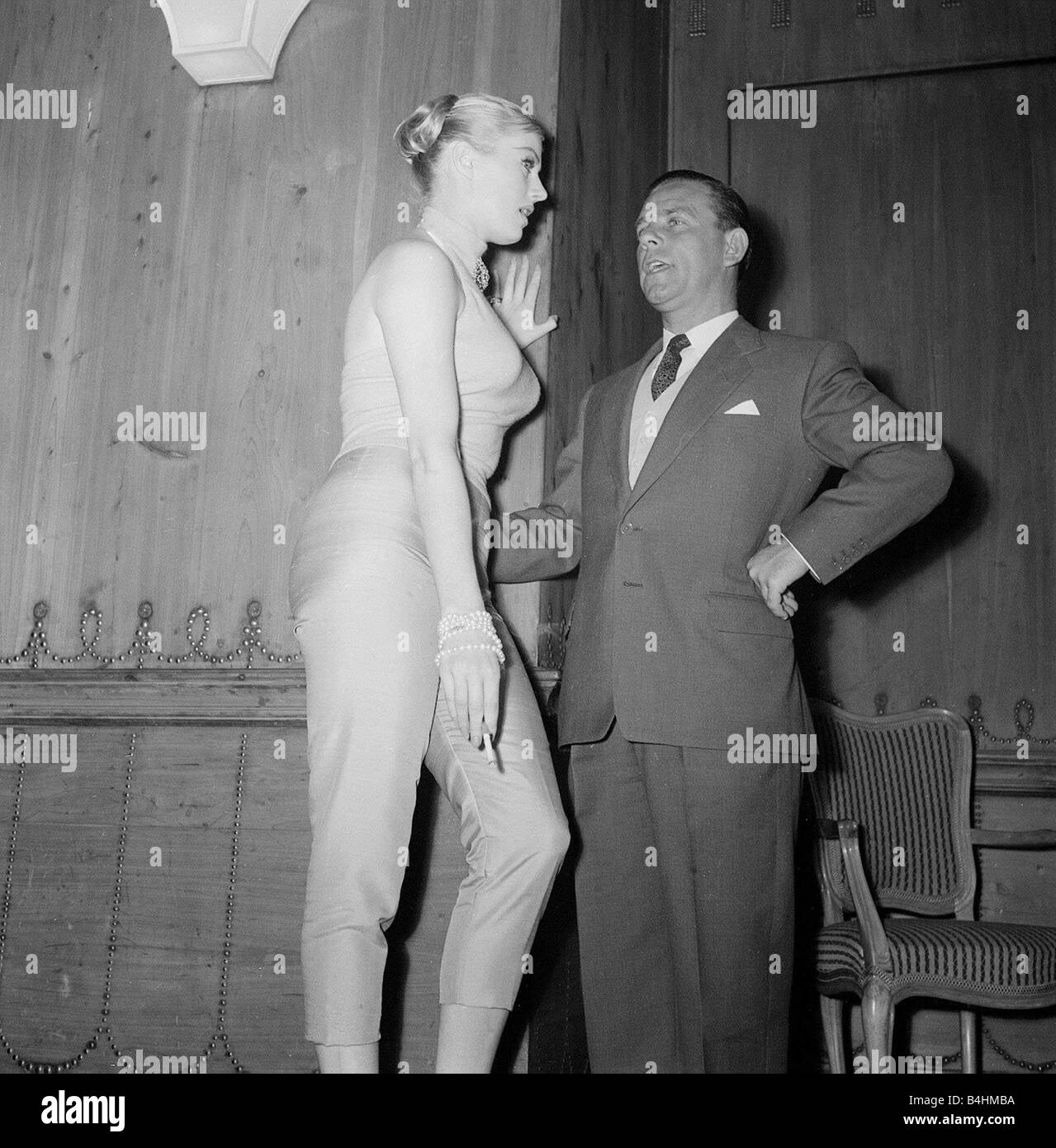Actor Norman Wisdom with actress Anita Ekberg at the Savoy Hotel in London May 1956 - Stock Image