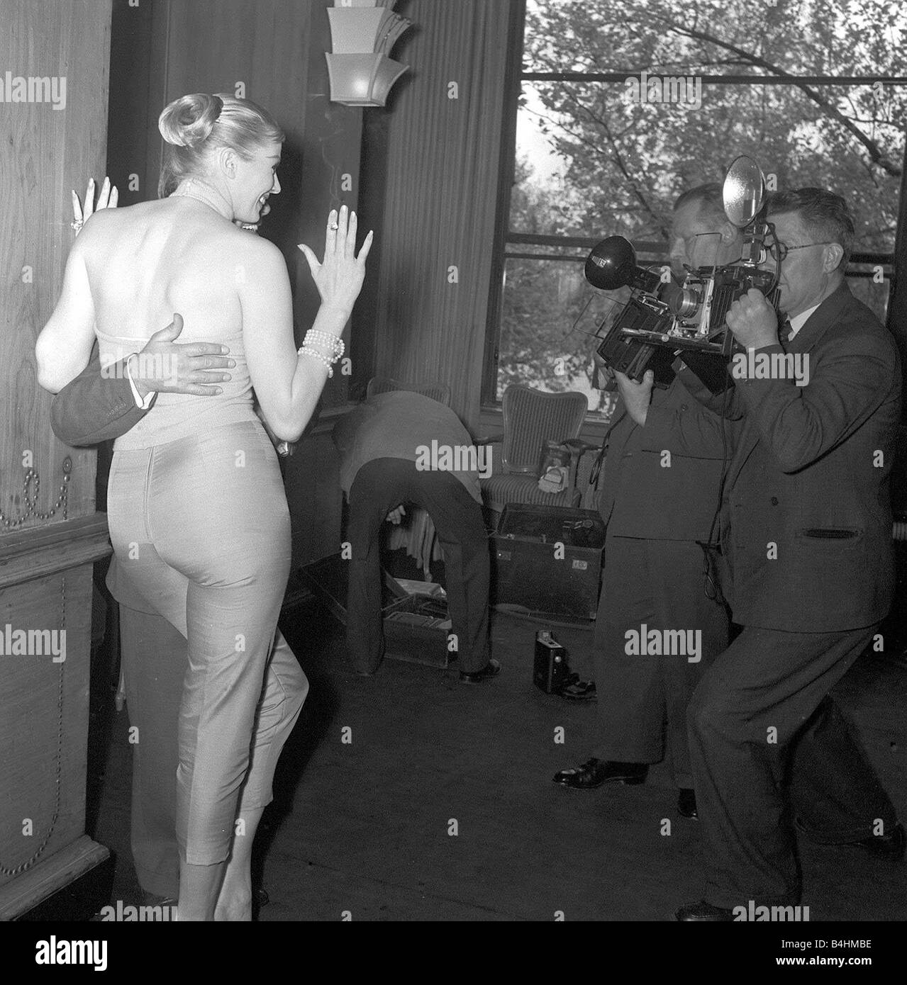 Comedian and actor Norman Wisdom poses for photographers with actress Anita Ekberg at the Savoy Hotel May 1956 - Stock Image