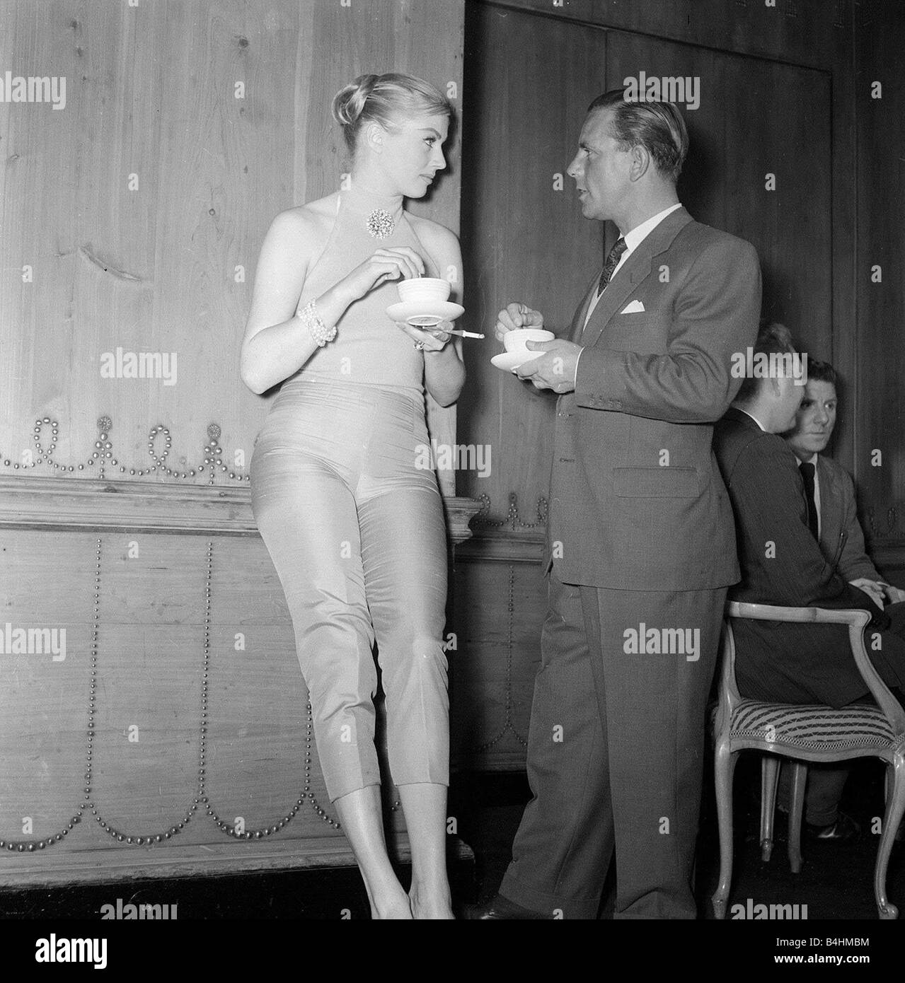 Actor and comedian Norman Wisdom enjoys a cup of tea with actress Anita Ekberg at the savoy Hotel May 1956 - Stock Image