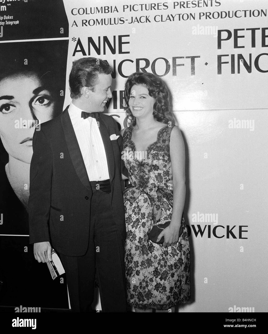 The Pumpkin Eater Film Premiere July 1964 Peter Benison Actor and Yvonne Buckingham Actress pictured arriving at - Stock Image