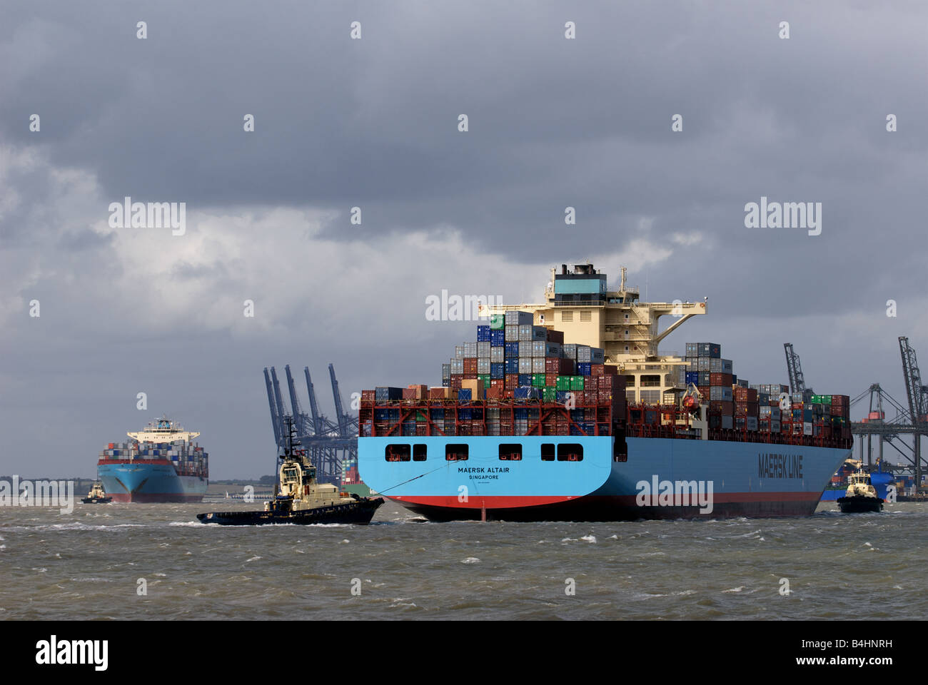 Containers ships arriving and departing the Port of Felixstowe, Suffolk, UK. - Stock Image