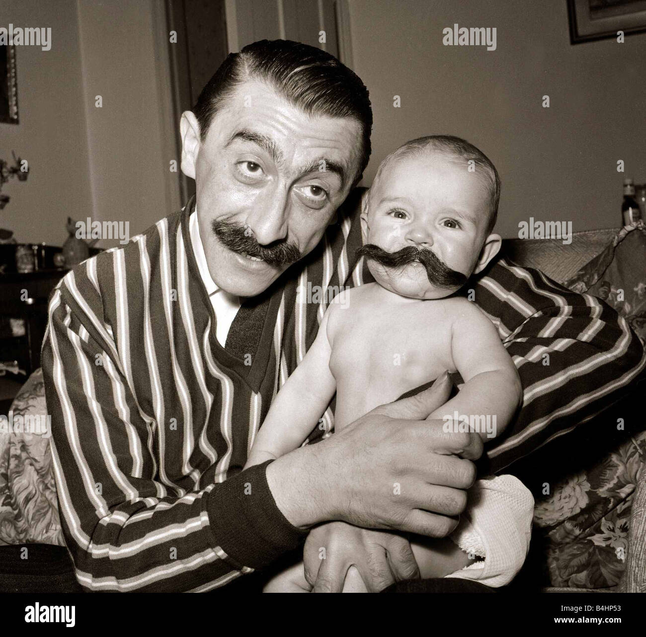Actor Mario Fabrizi 1961 with his 5 month old baby son Anthony Fabrizi Big moustaches November 1961 1960s Cute babies child kid
