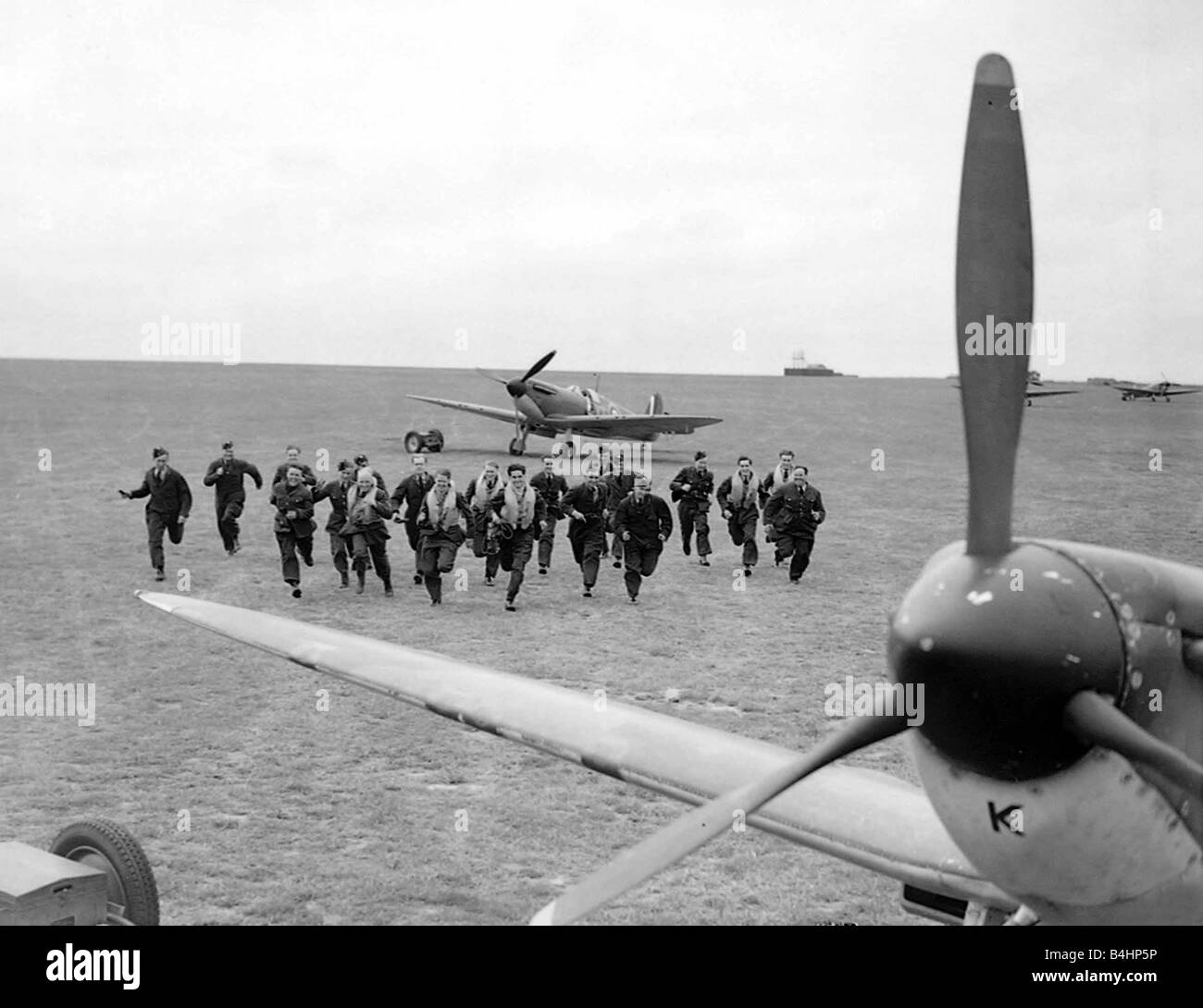 RAF Pilots scramble during th Battle of Britain Conflict World War Two Pilots running Aircraft Fighter Supermarine - Stock Image