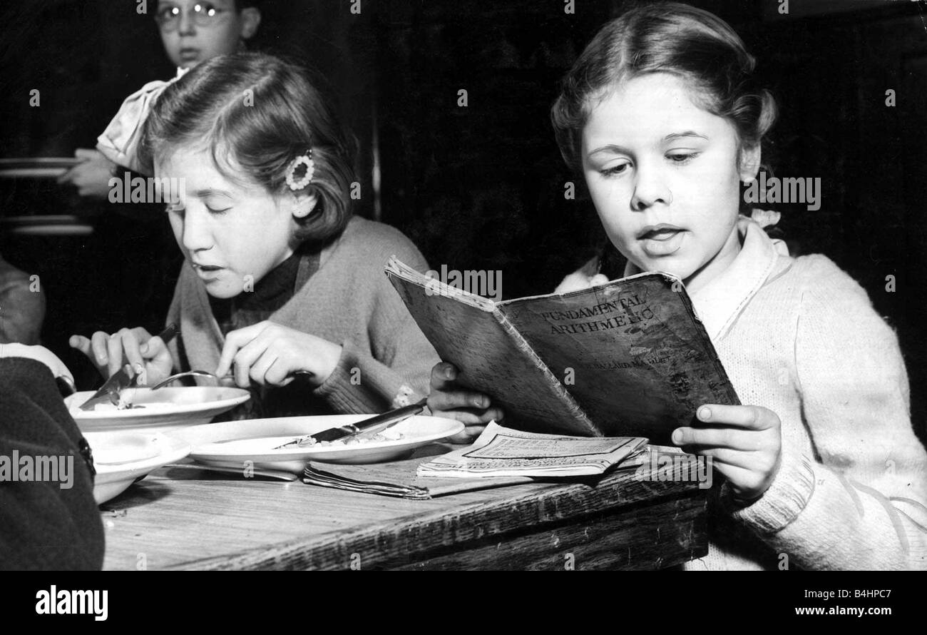 Over 37000 children in London s L C C scholos today sat down with pen and examination papers The results of the - Stock Image