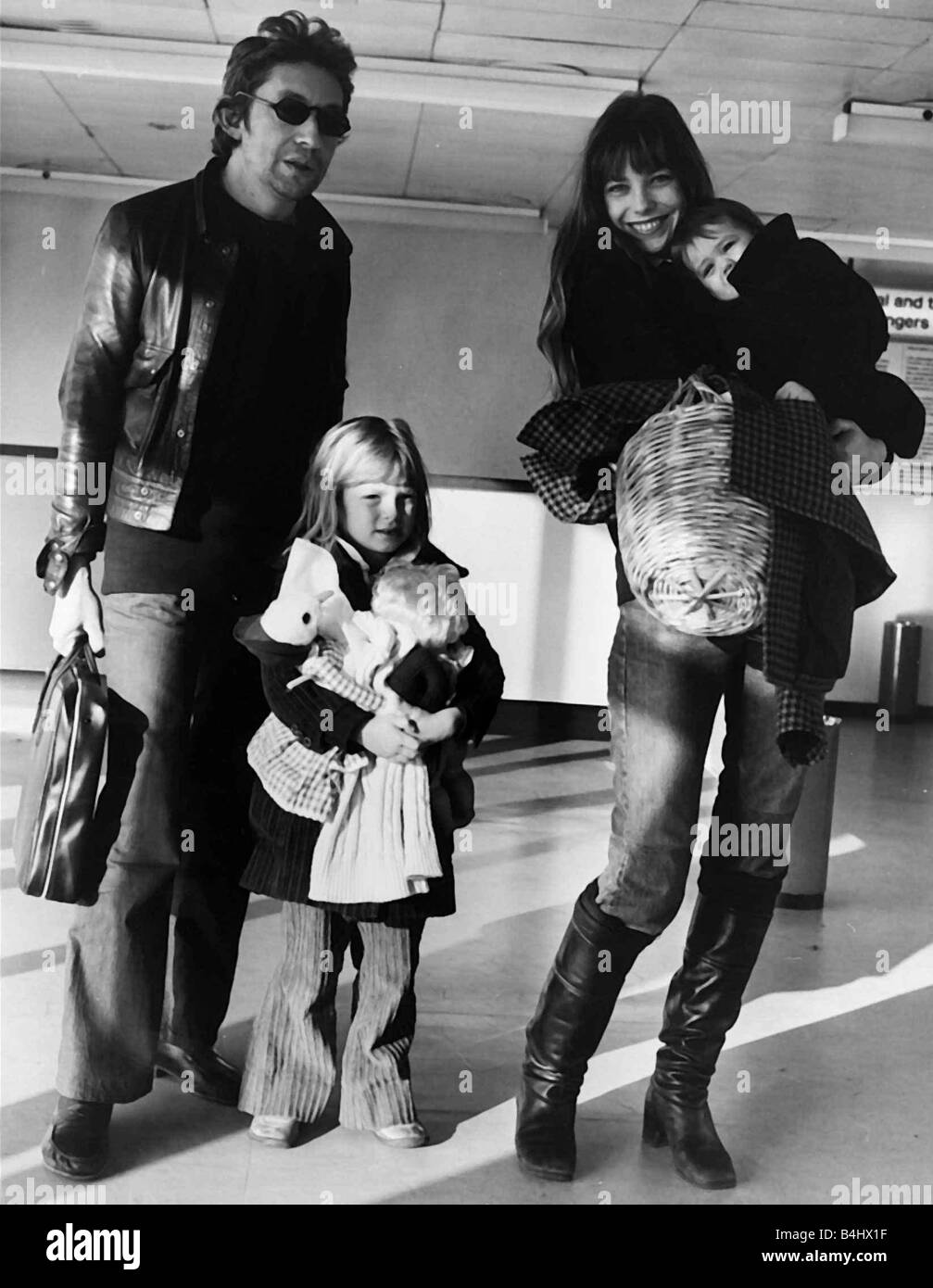 Serge Gainsbourg French composer musician and family 1973 actress wife Jane  Birkin and children at Heathrow Airport