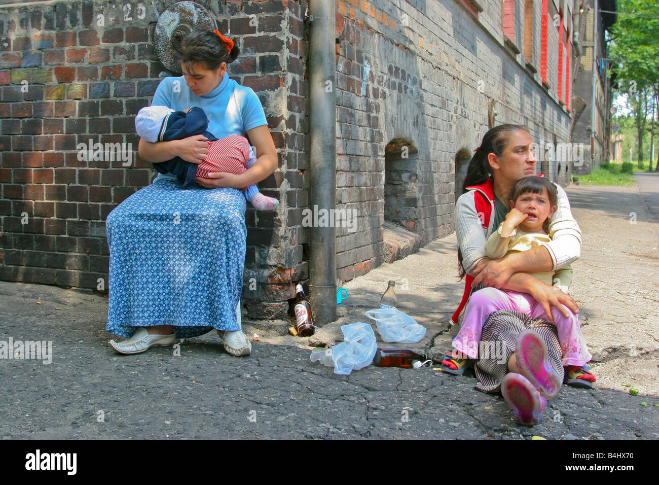 Two gypsy women with babies in gypsy enclave Bytom, Poland - Stock Image