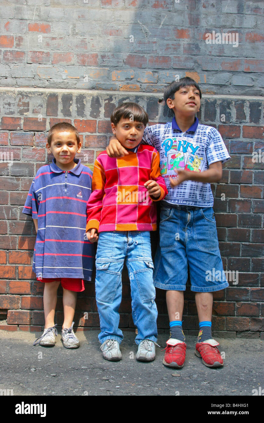 A group of gypsy children in roma enclave Bytom, Poland. - Stock Image