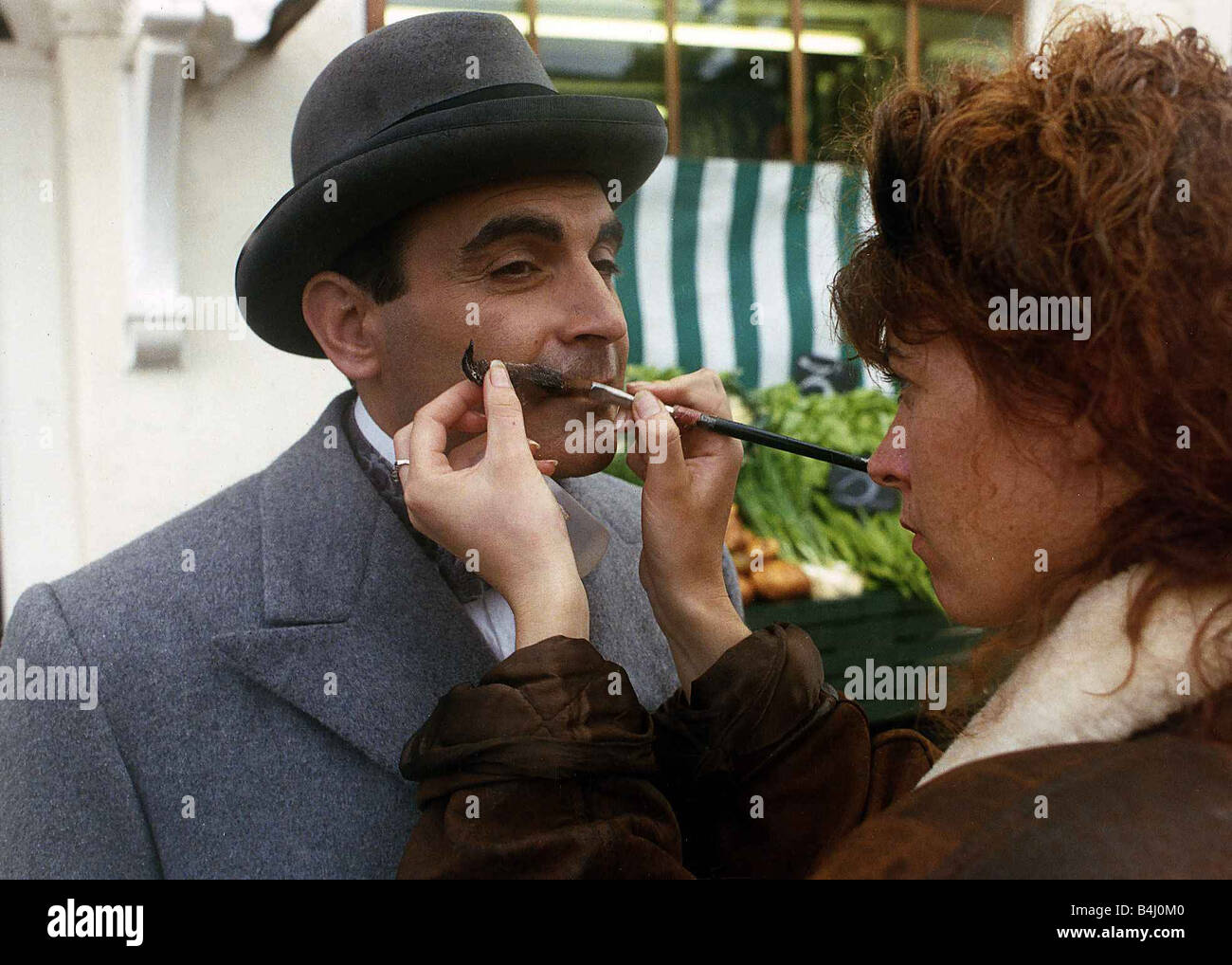 David Suchet Actor has his moustache adjusted while on the set of the TV programme Poirot November 1989 - Stock Image
