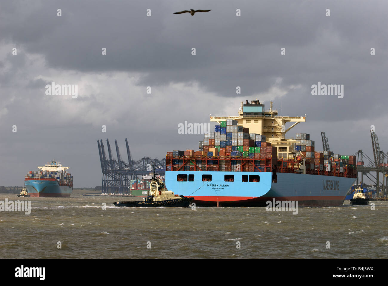 Arrival and departure of container ships at the Port of Felixstowe, Britain's largest container terminal, Suffolk, - Stock Image