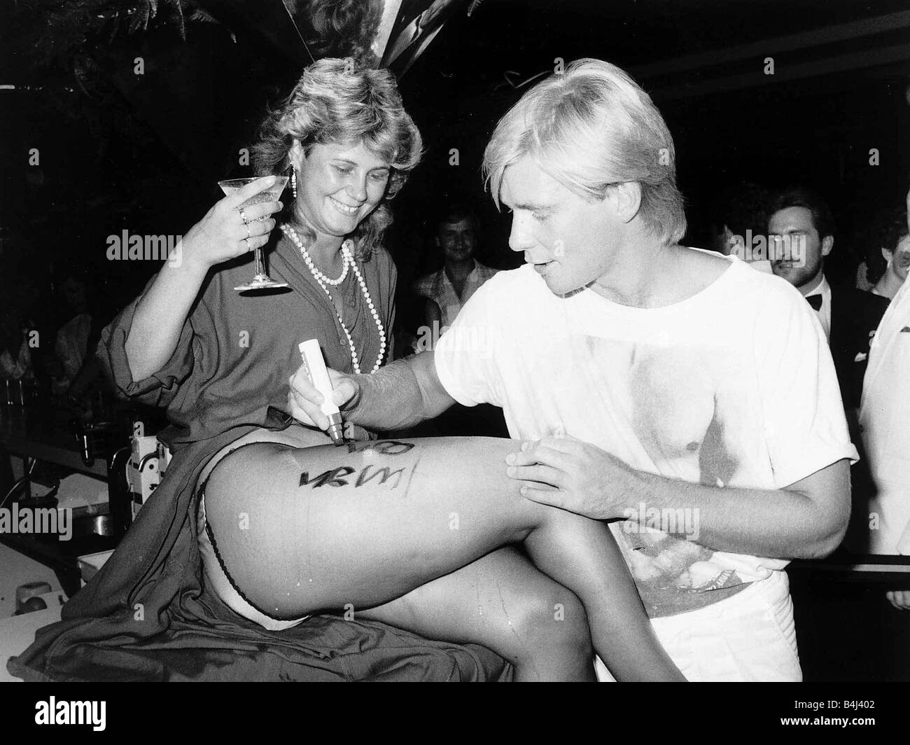 Jason Connery Actor Robin of Sherwood Son of Sean Connery signing his autograph on secretary Donna Hulin s thigh - Stock Image