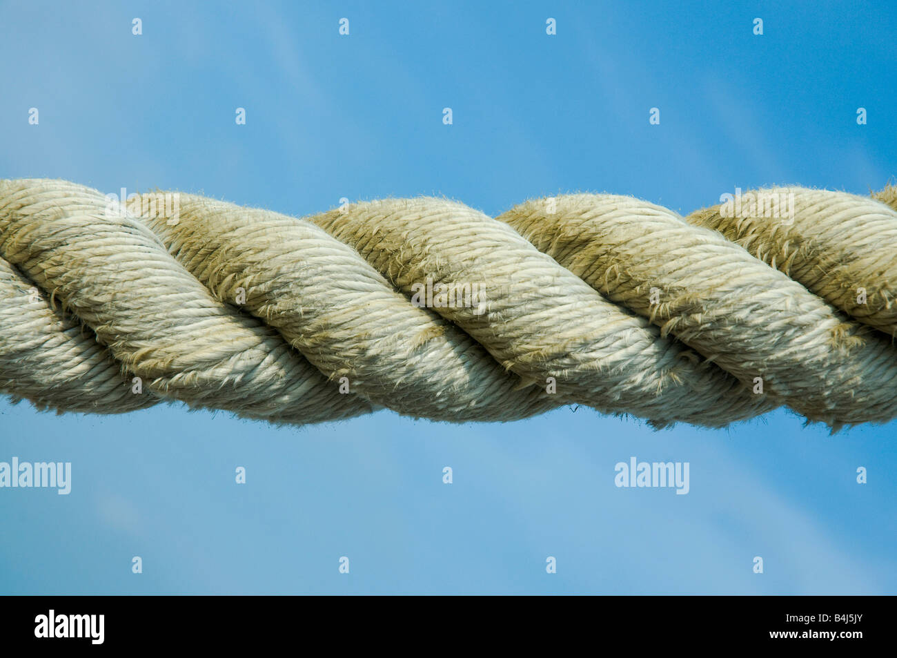 Rope against blue sky - Stock Image