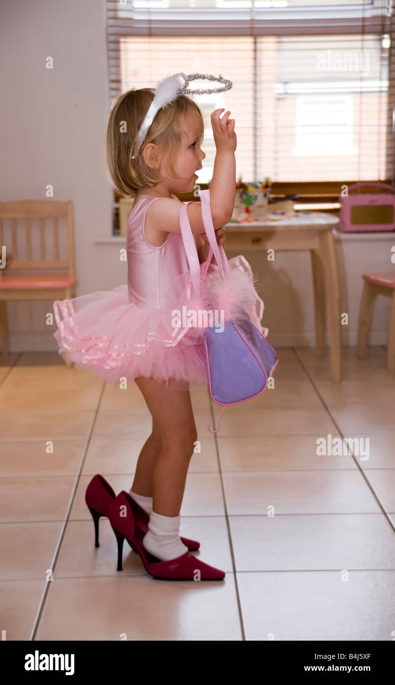 8d3df5621 little girl dressed in a tutu and high heels Stock Photo: 20068791 ...