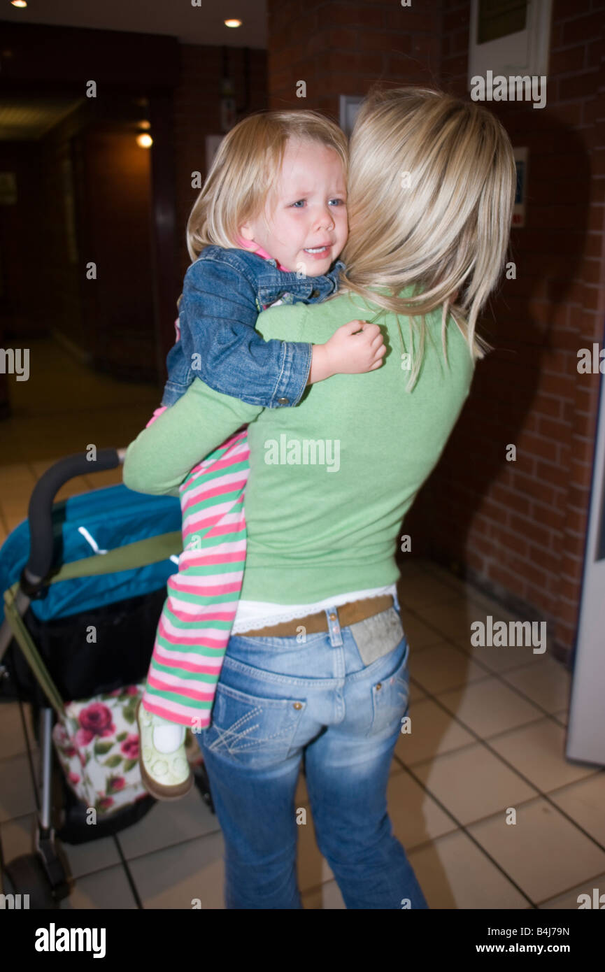 little girl having a tantrum in a shopping centre - Stock Image