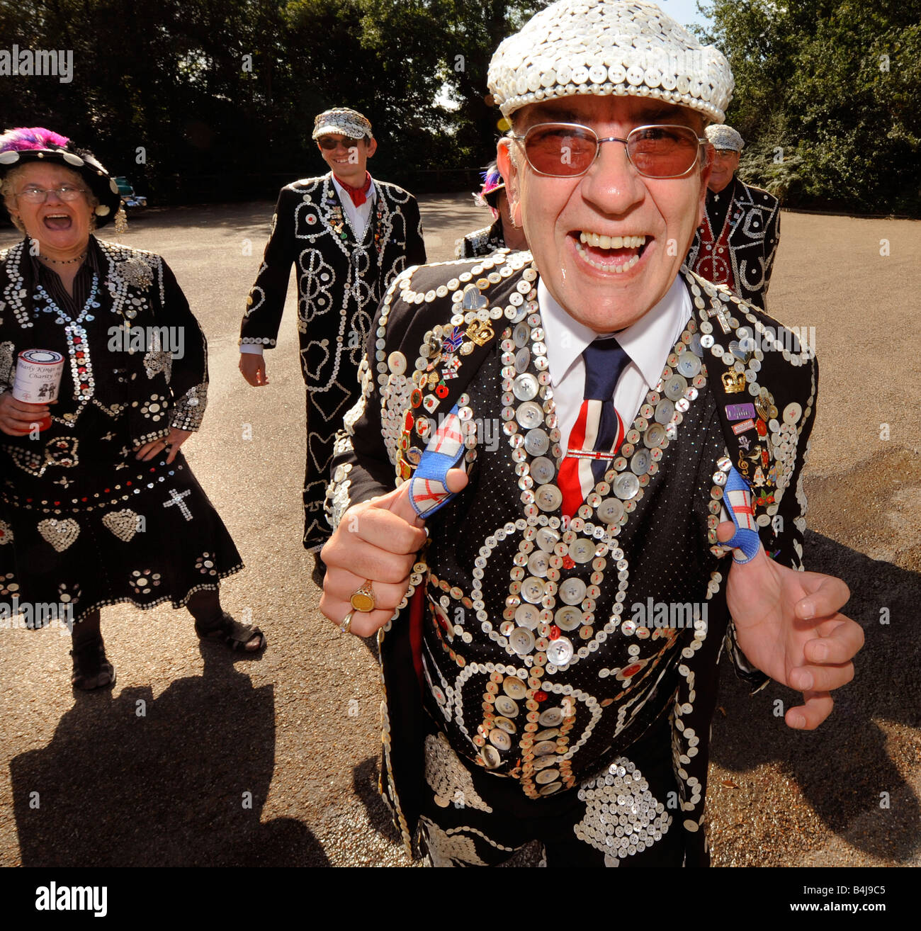 The Pearly Kings and Queens visit Chartwell in Kent. A very jolly gentleman laughs into the camera. - Stock Image
