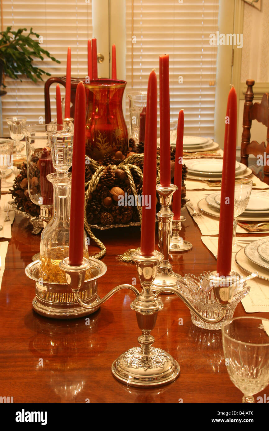 Silver Candle Stick Holders With Red Candles On Formal Dining Table Stock Photo Alamy