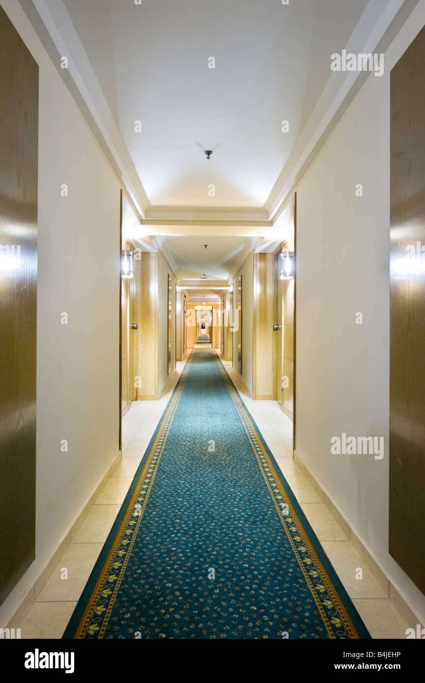 Empty hotel corridor at night - Stock Image