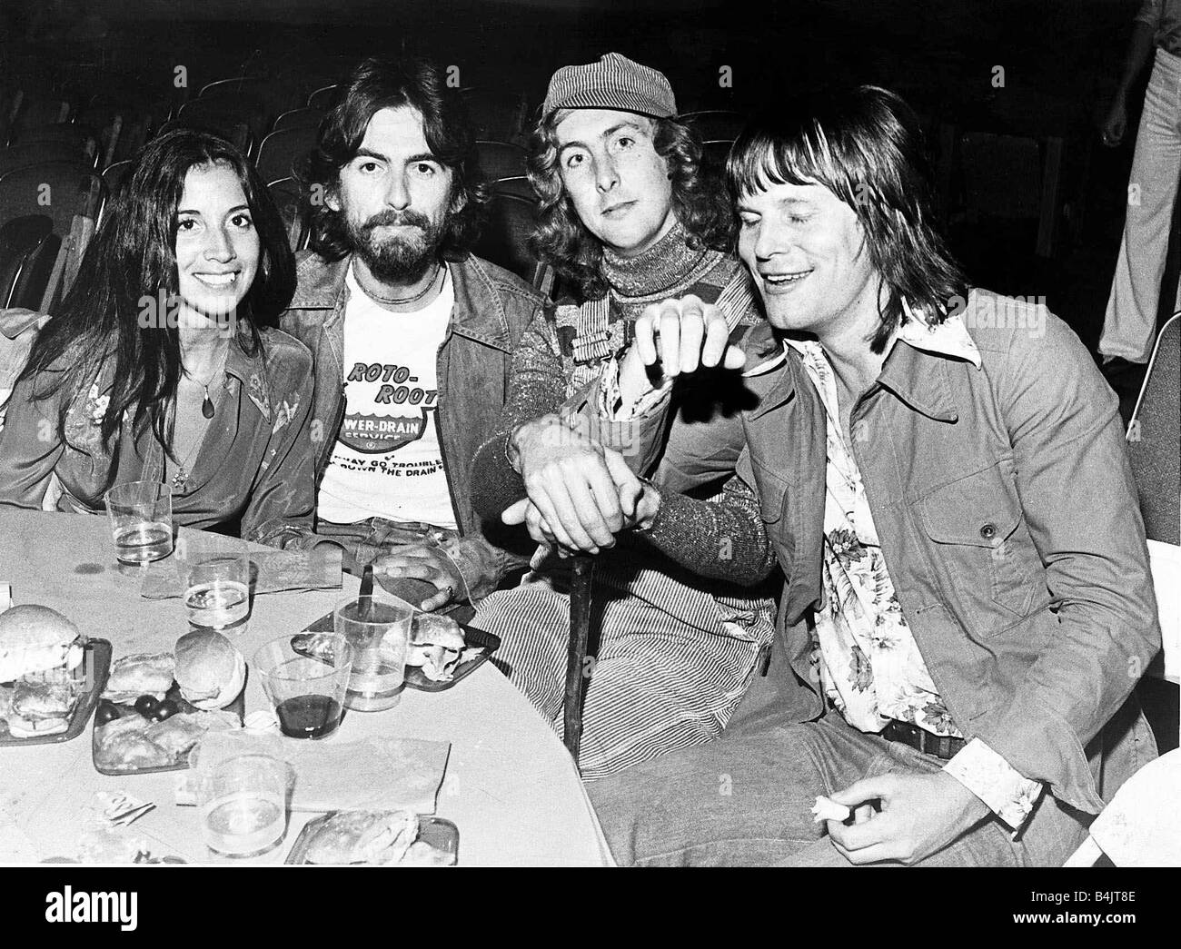L R Olivia Arias Ex Beatle George Harrison Eric Idle And Tery Gilliam At The Premire Of Monty Python Holy Grail In Hollywood July 1975 March 29